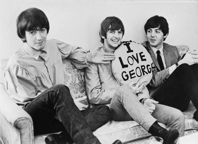 Three of the four members of the British rock group The Beatles in 1964