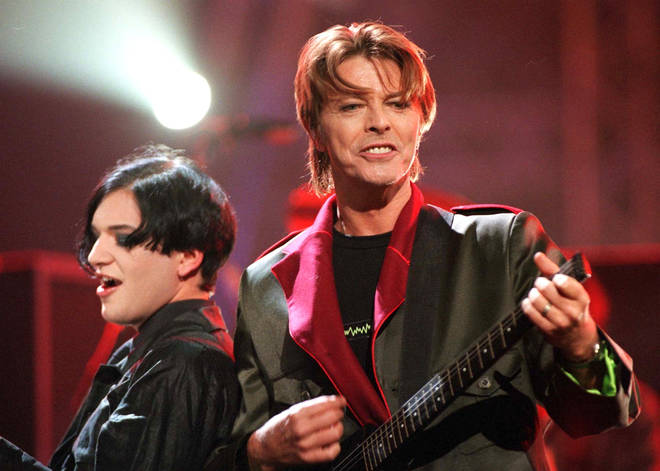David Bowie and Brian Molko of Placebo performing at the Brit Awards in 1999