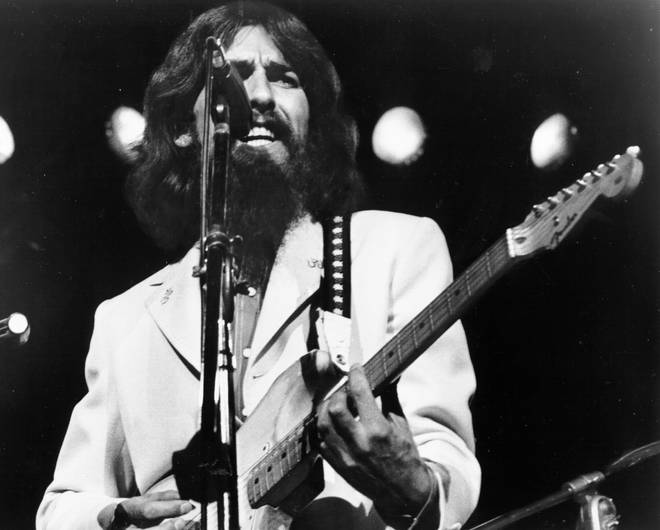 George Harrison performing on stage in 1971