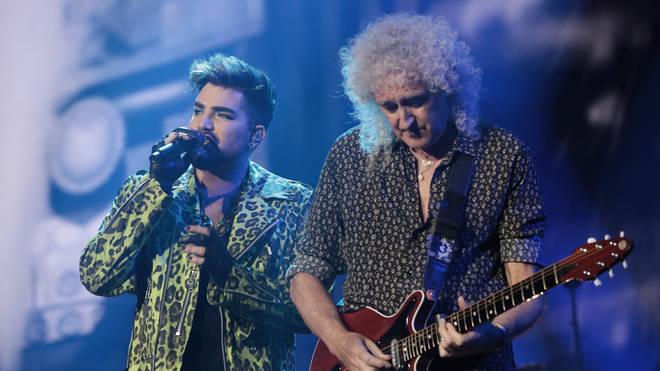 Brian May performing with Adam Lambert