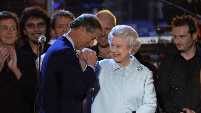 "Prince Charles joined the musicians on stage to pay tribute to his ""Mummy"" and give her a kiss on the hand. Pictured, The Queen and Prince Charles, June 2, 2002"