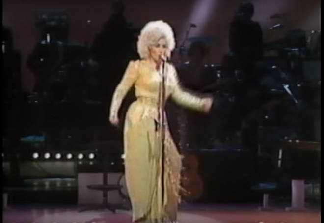 Dolly Parton did a hilarious impression of Elvis Presley by singing a brilliant cover of The King's 1957 hit, 'All Shook Up'.