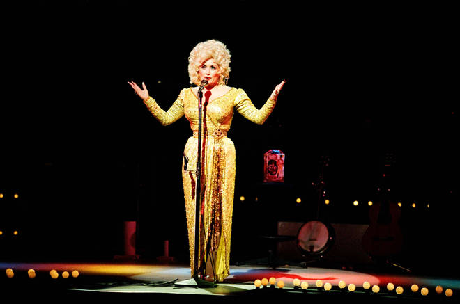 """The video comes after Dolly Parton recently opened up about a clash she had with Elvis Presley which left her """"crying all night"""". Pictured, on stage at The Dominion Theatre in 1983."""