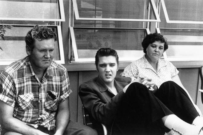 Elvis Presley with his parents Vernon and Gladys