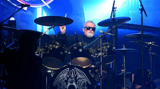 Roger Taylor performing with Queen