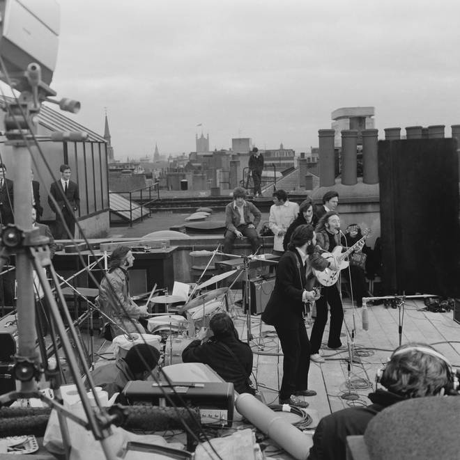 The Beatles perform on the rooftop of Apple's London office on Savile Row